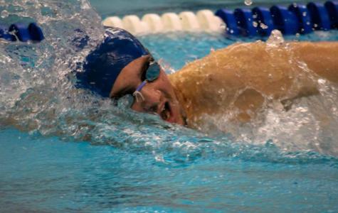 Three-season winning streak ends in tight loss for boys swimming