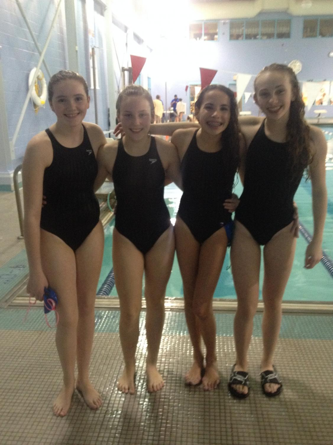 8th grade swimmers Lindsay Kenney, Chloe Bramlett, Hailey Stuck, and Meghan Pinter are freshman now and still swimming