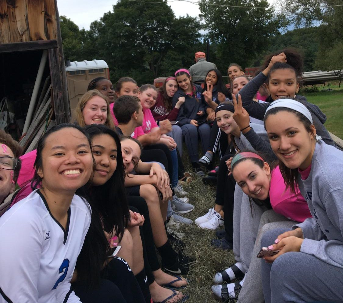 Girl's volleyball goes pumpkin picking as part of their team building activities.
