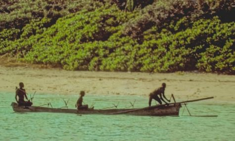 The Sentinelese fish on one of their handmade canoes.