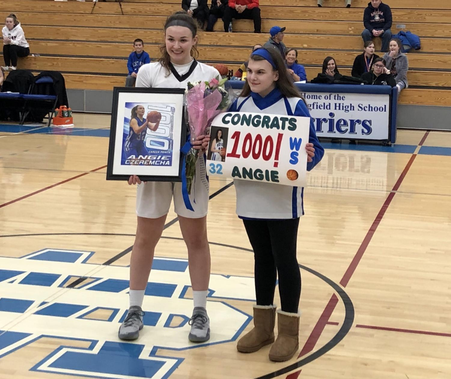 Angie Czeremcha and her sister Gina Czeremcha celebrates Angie's 1,000th point.