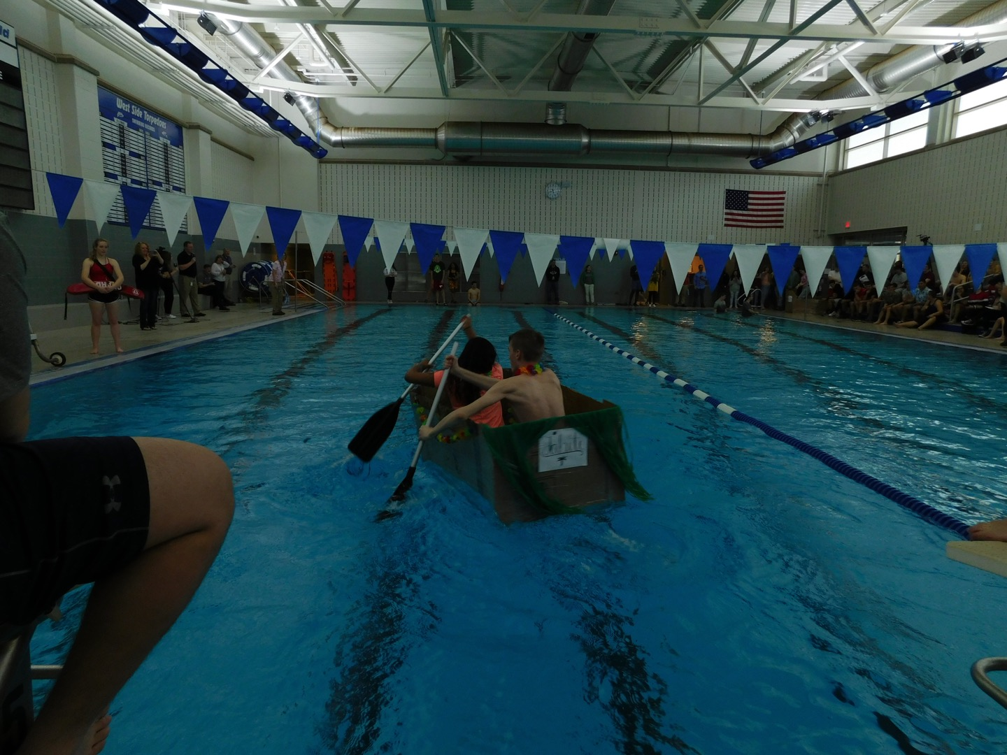 Two participants, Kristen Palwan and Ivan Zubik race in their boat,