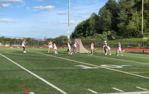 Tight-Knit Girls' Lacrosse Team Finds Success