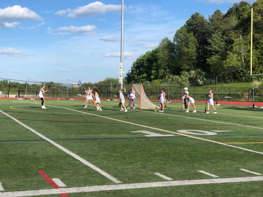 The+lacrosse+team+warms+up+before+their+last+league+game.
