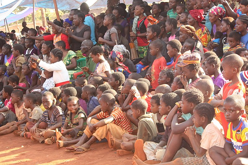 Children sit together at the Nyarugusu Camp in Tanzania, where Beliya Makala grew up.