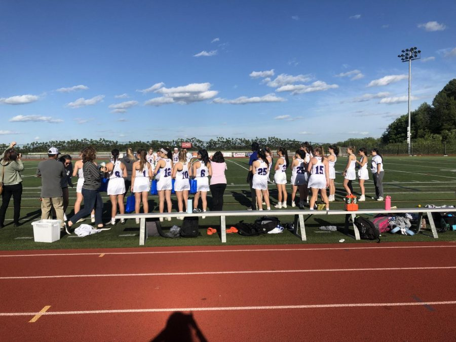 The girls lacrosse team on their senior night during the 2019 spring season.