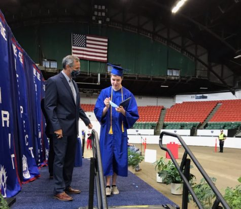 Senior Riley Aronson receiving his diploma at the WSHS drive-through graduation ceremony June 6.
