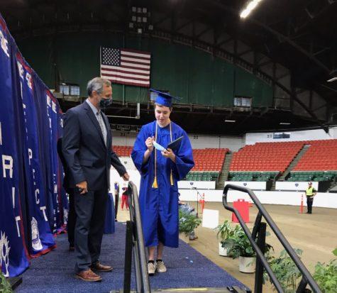 Senior Riley Aronson receiving his diploma at the WSHS drive-through graduation ceremony June 6.
