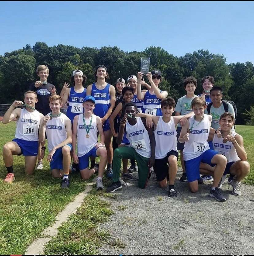 The Boys Cross Country team pictured here celebrating winning the Valley South League Championship for the first time since 2016. The team is currently undefeated.